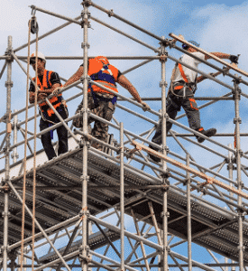 Construction workers on scaffolding rig